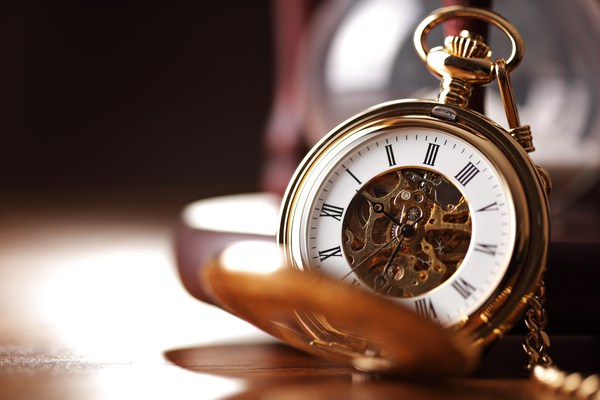 pocket watch open on the table
